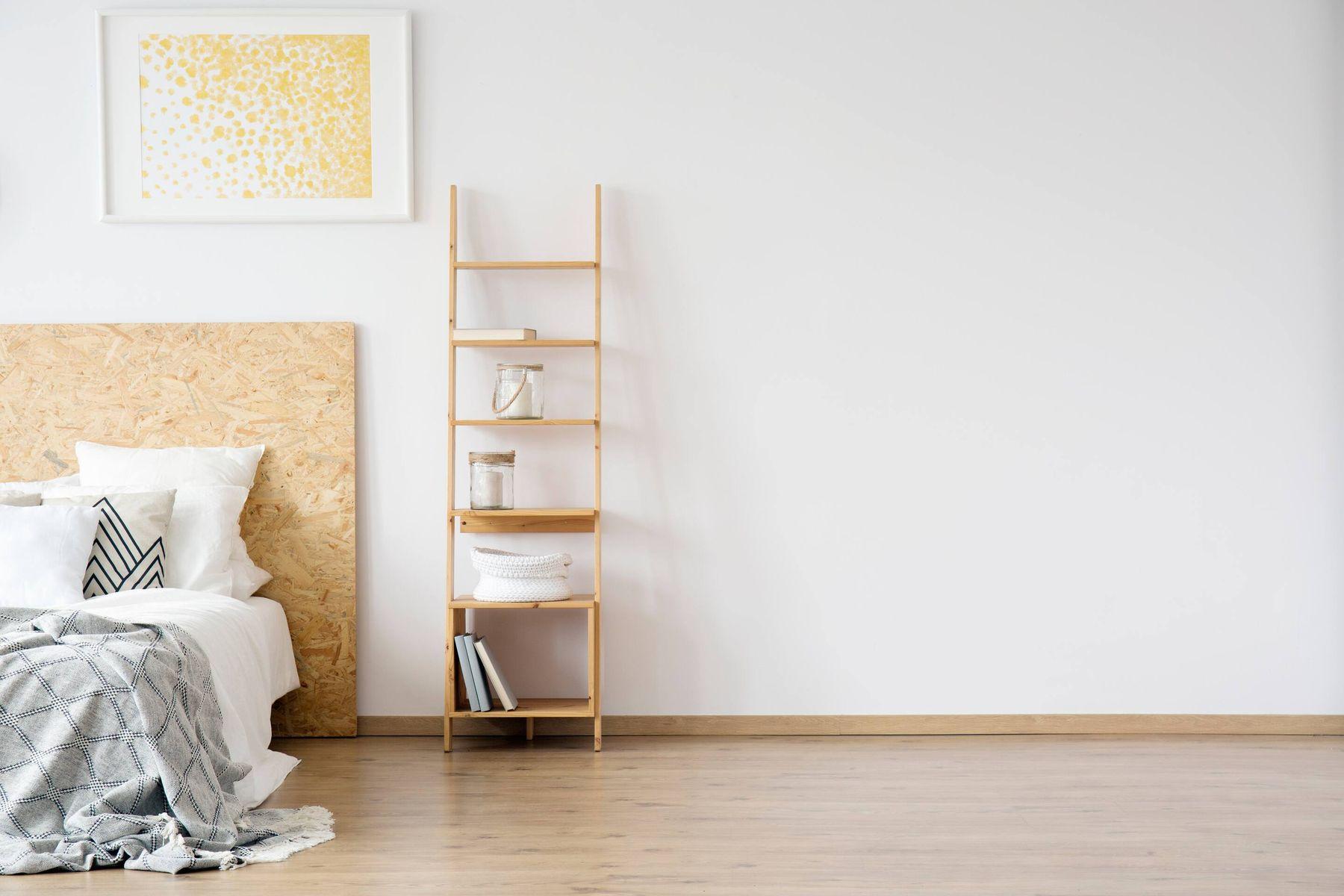 wooden ladder shelf in bedroom