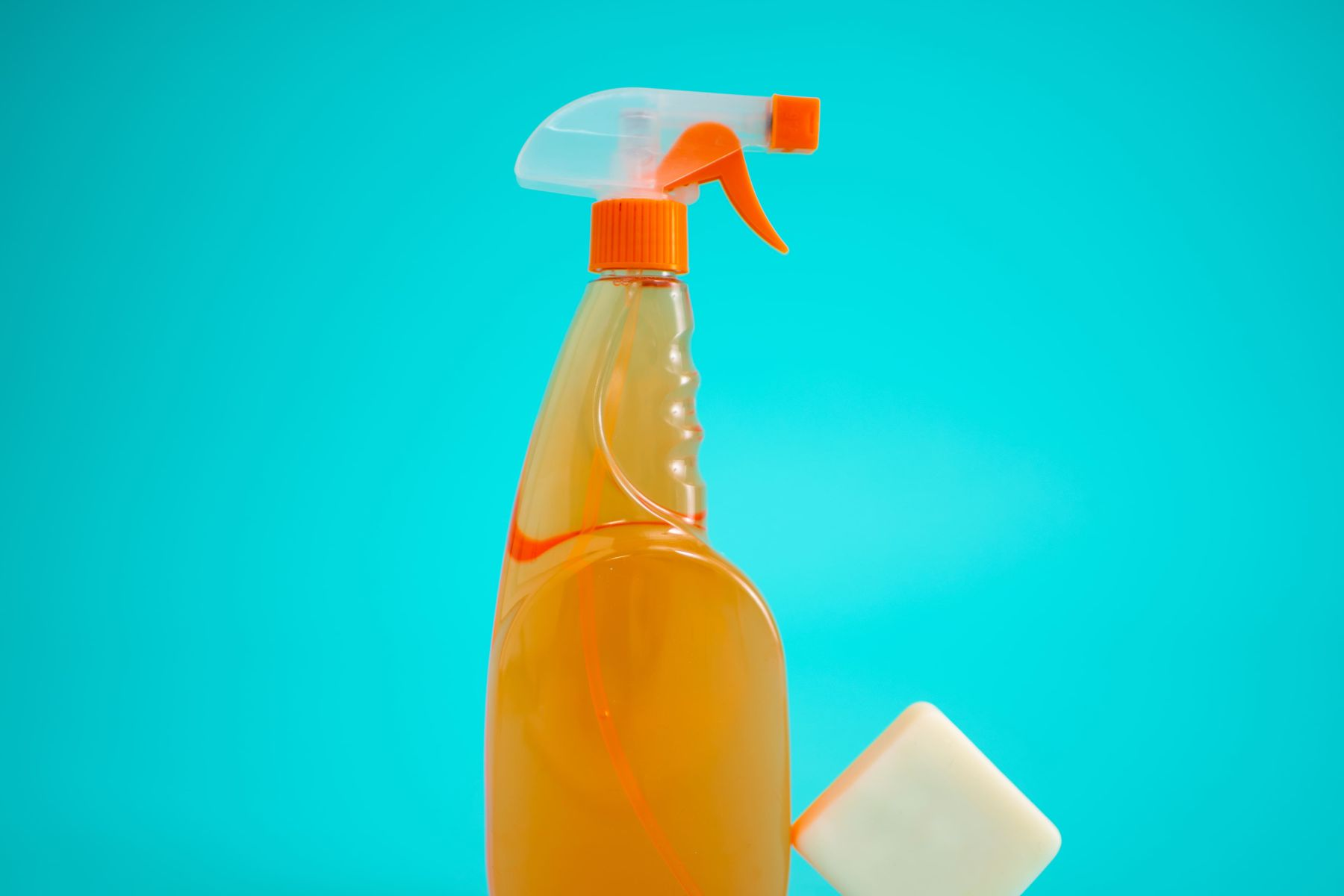Yellow spray bottle with a product for deep cleaning the house