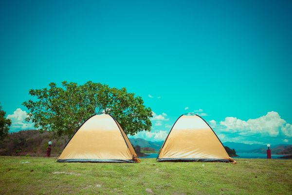 two-tents-on-a-grassy-knoll
