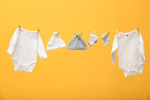 baby clothes on a line-1441174-1800w-1200h