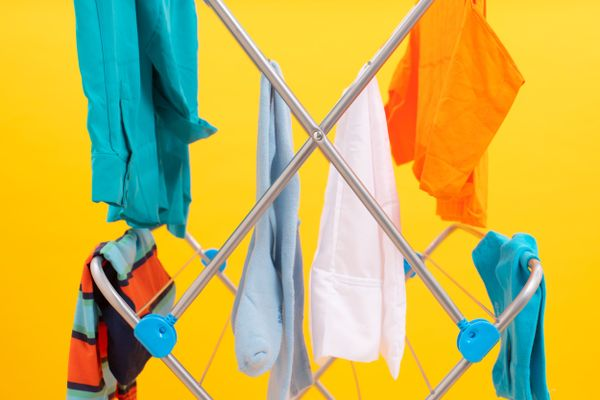 newly washed clothes drying on a laundry rack