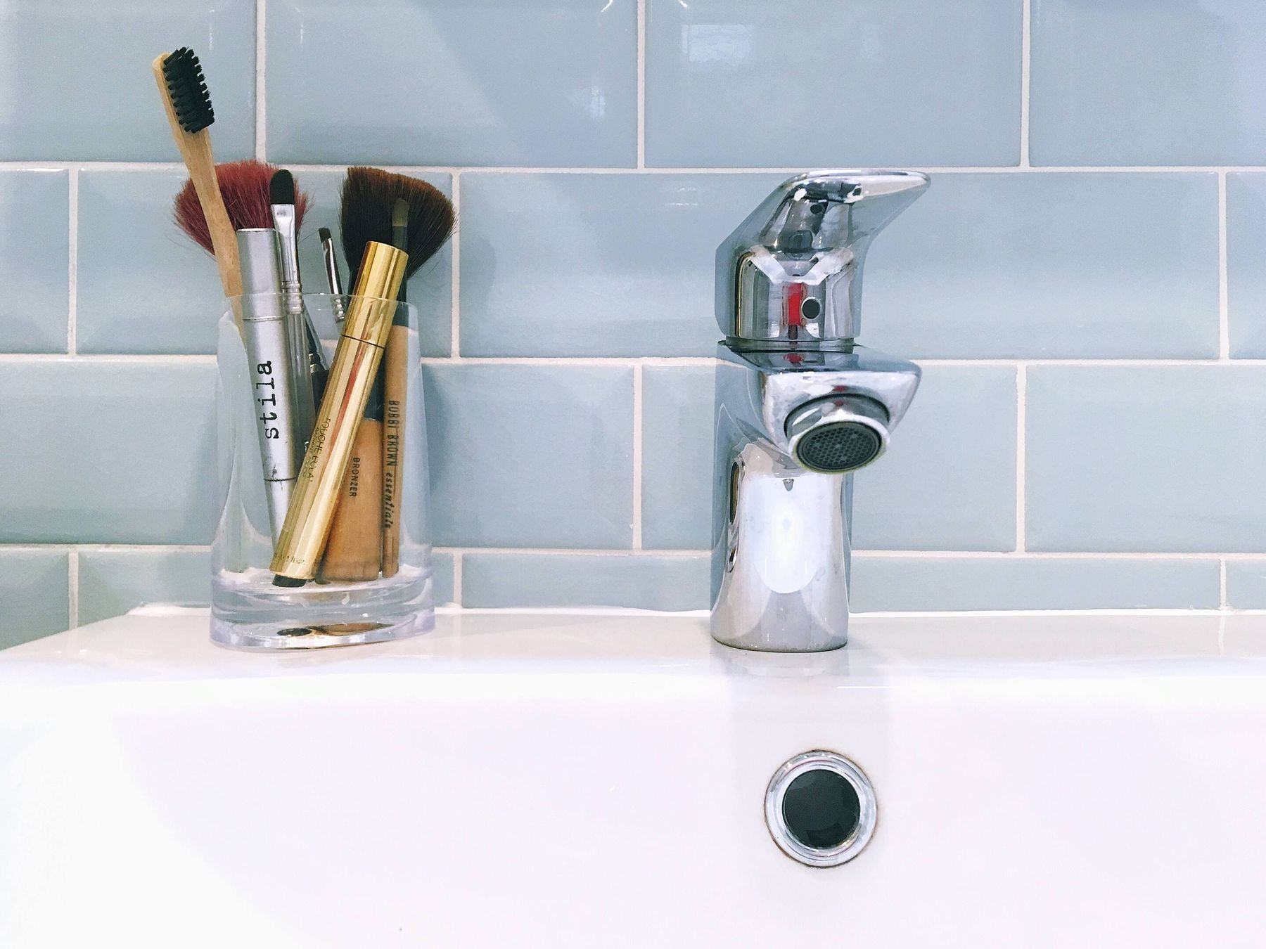 make-up brushes on the sink