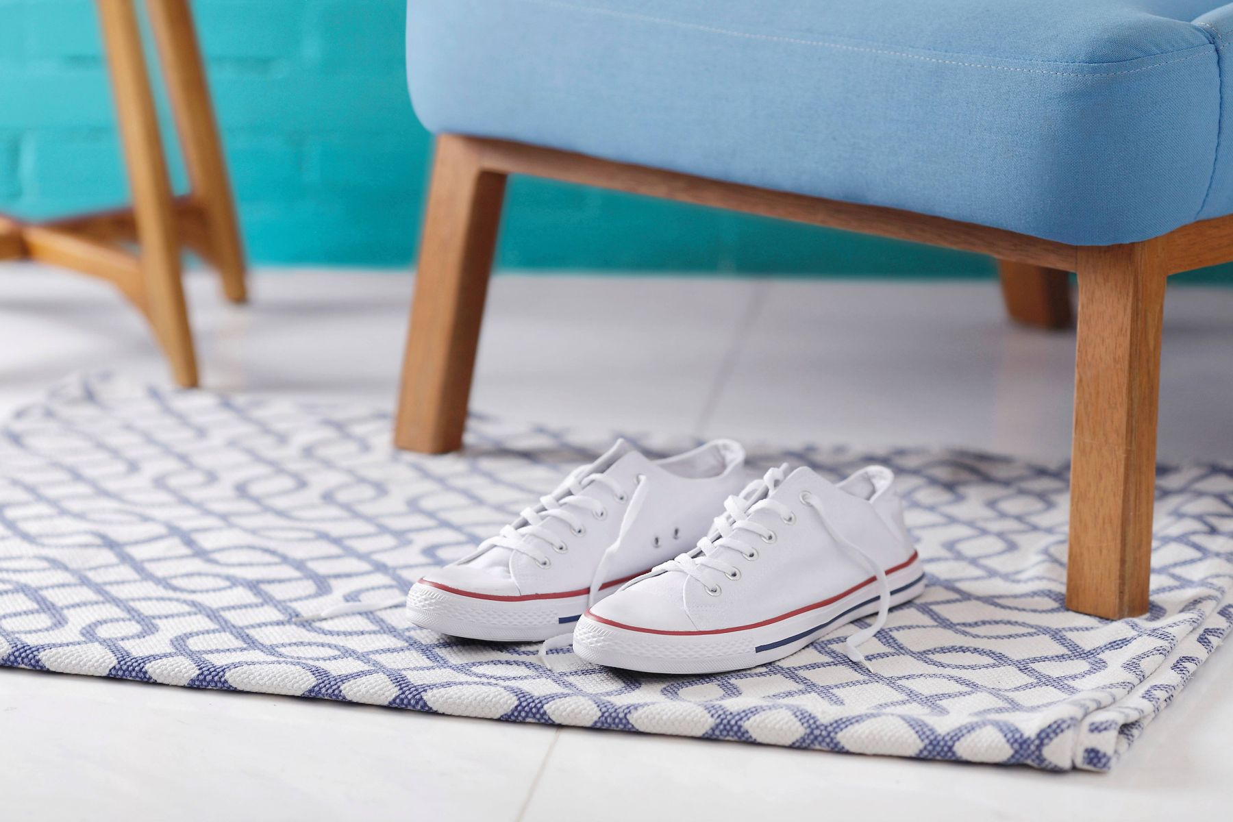 white converse on a printed carpet