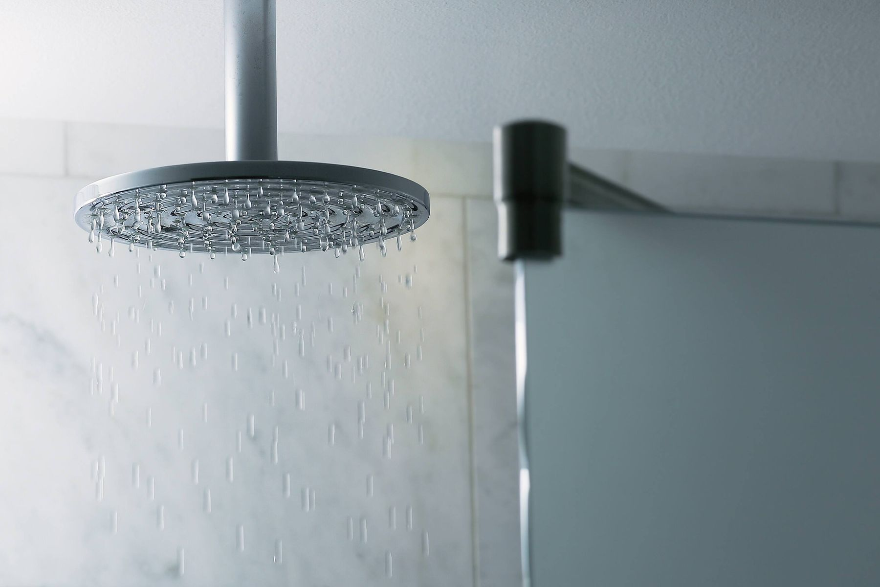 Too many blotchy paint stains on your shower head post renovation? Here's how you can get them off