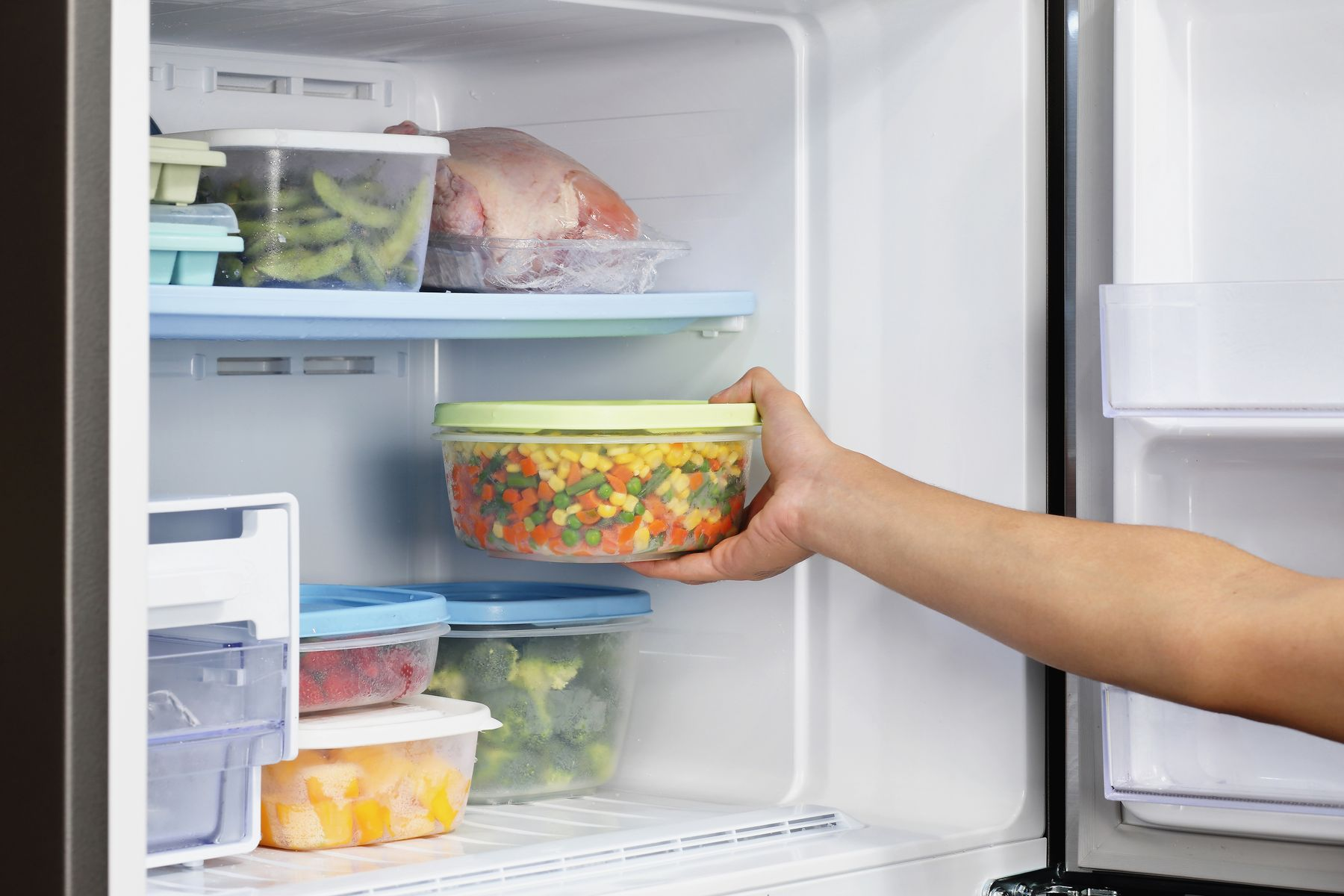 Step 7: person putting food back in fridge