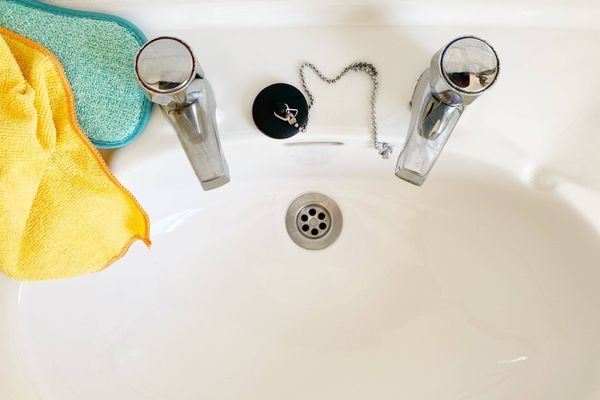 clean sink with cleaning cloths