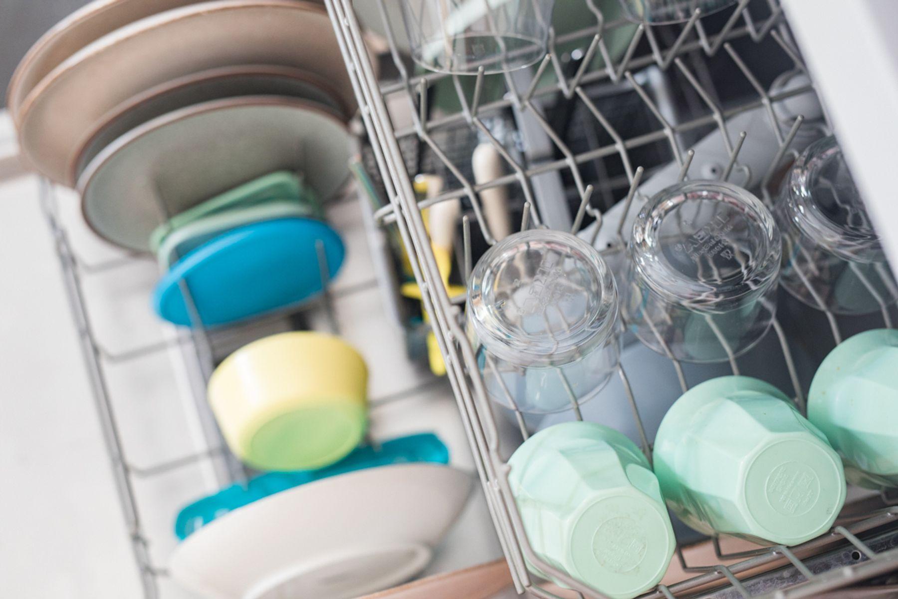An open, loaded dishwasher