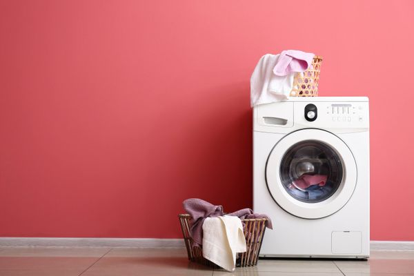 washing machine against pink background
