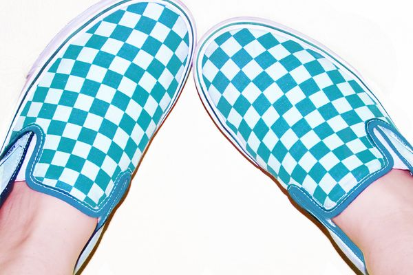 a pair of blue checkered Vans
