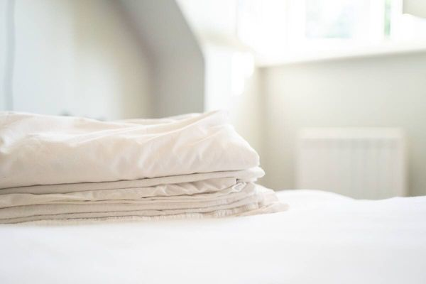 Folded bedsheets on a bed