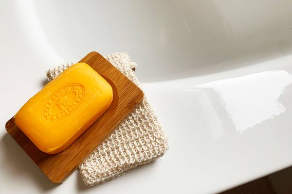 handmade soap and vegetable loofah over the bathroom sink