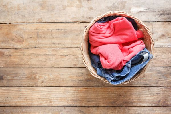 laundry in a basket on a wooden floor