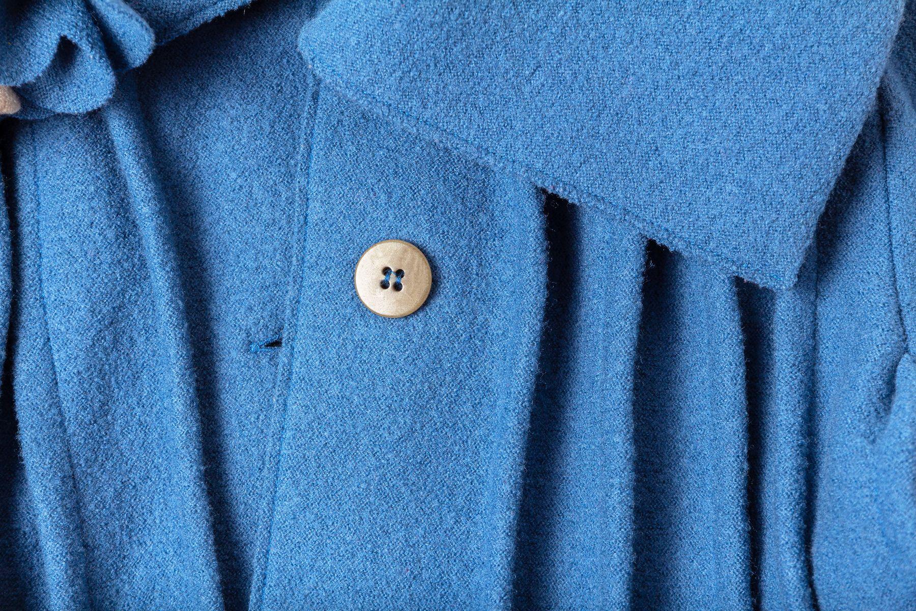 A closeup of a blue woollen coat