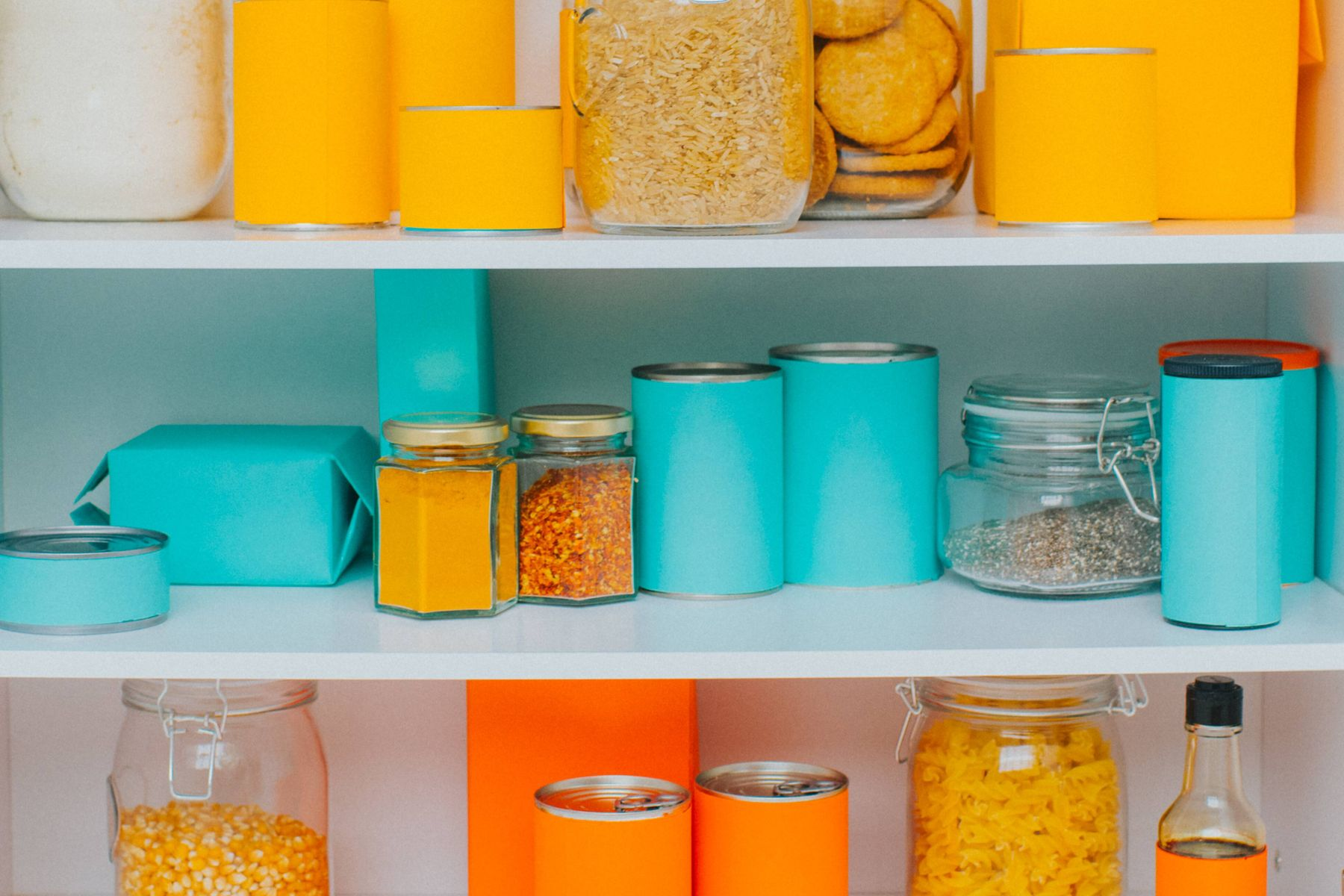 Tidy pantry shelves filled with containers for kitchen storage solutions: how to keep your kitchen clean and tidy