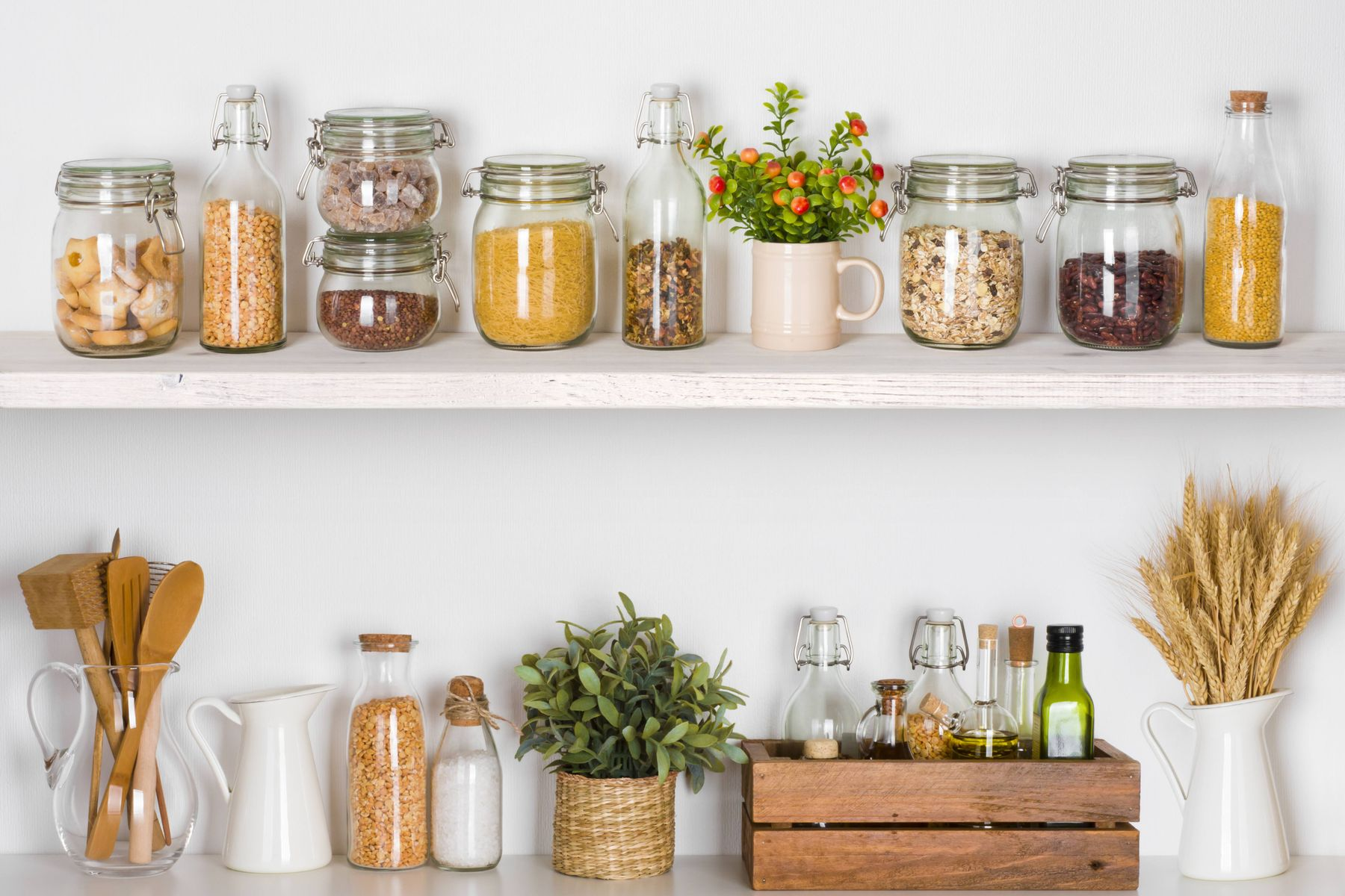 Mason jar crafts and containers sitting on a shelf with dried foods