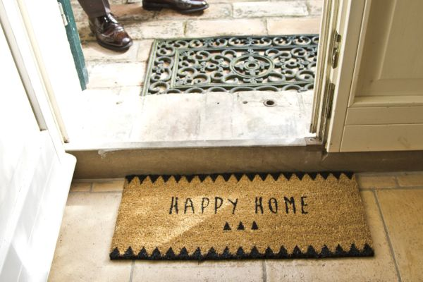 door mat welcoming to a clean home