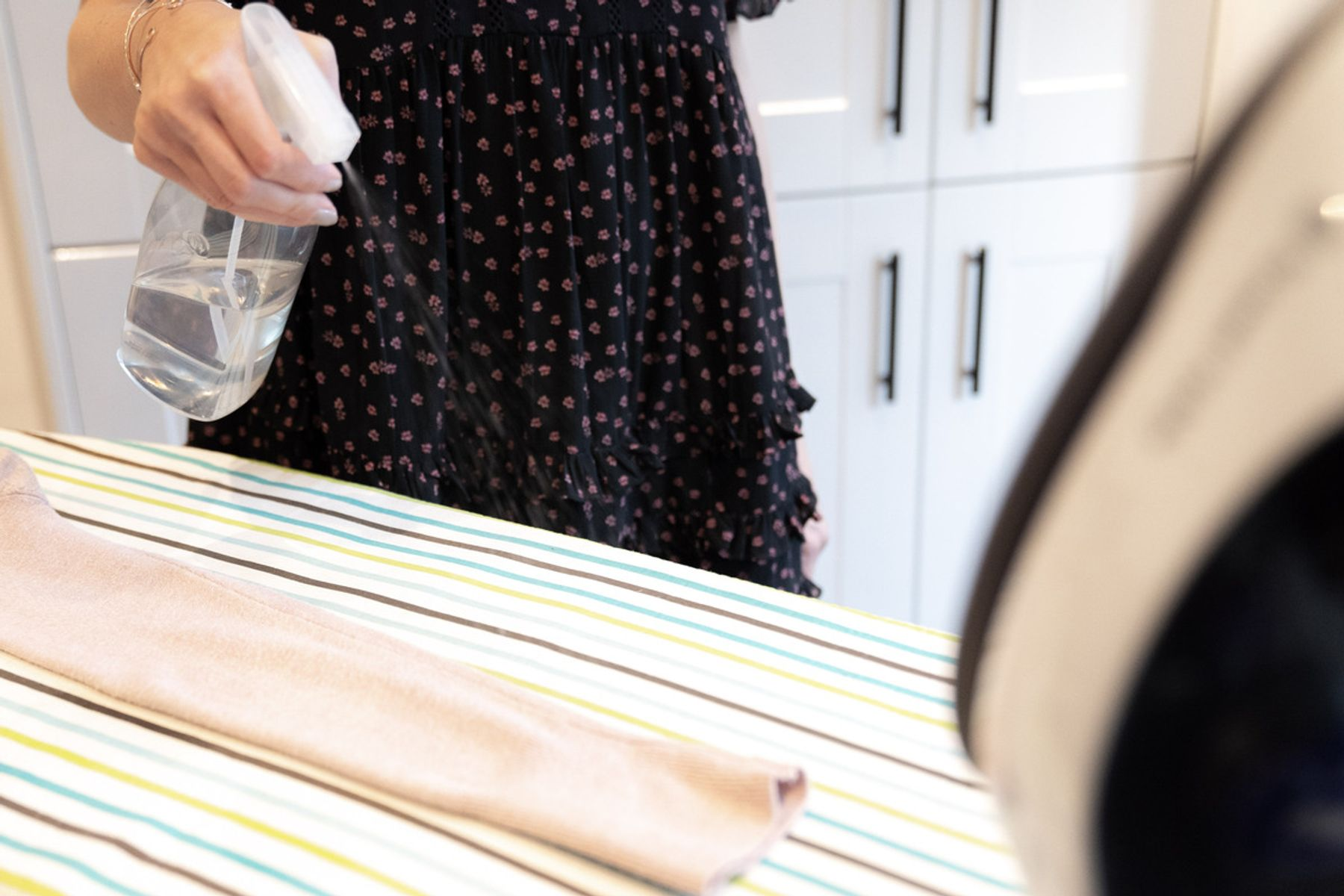 Using an ironing spray on a garment before it gets ironed