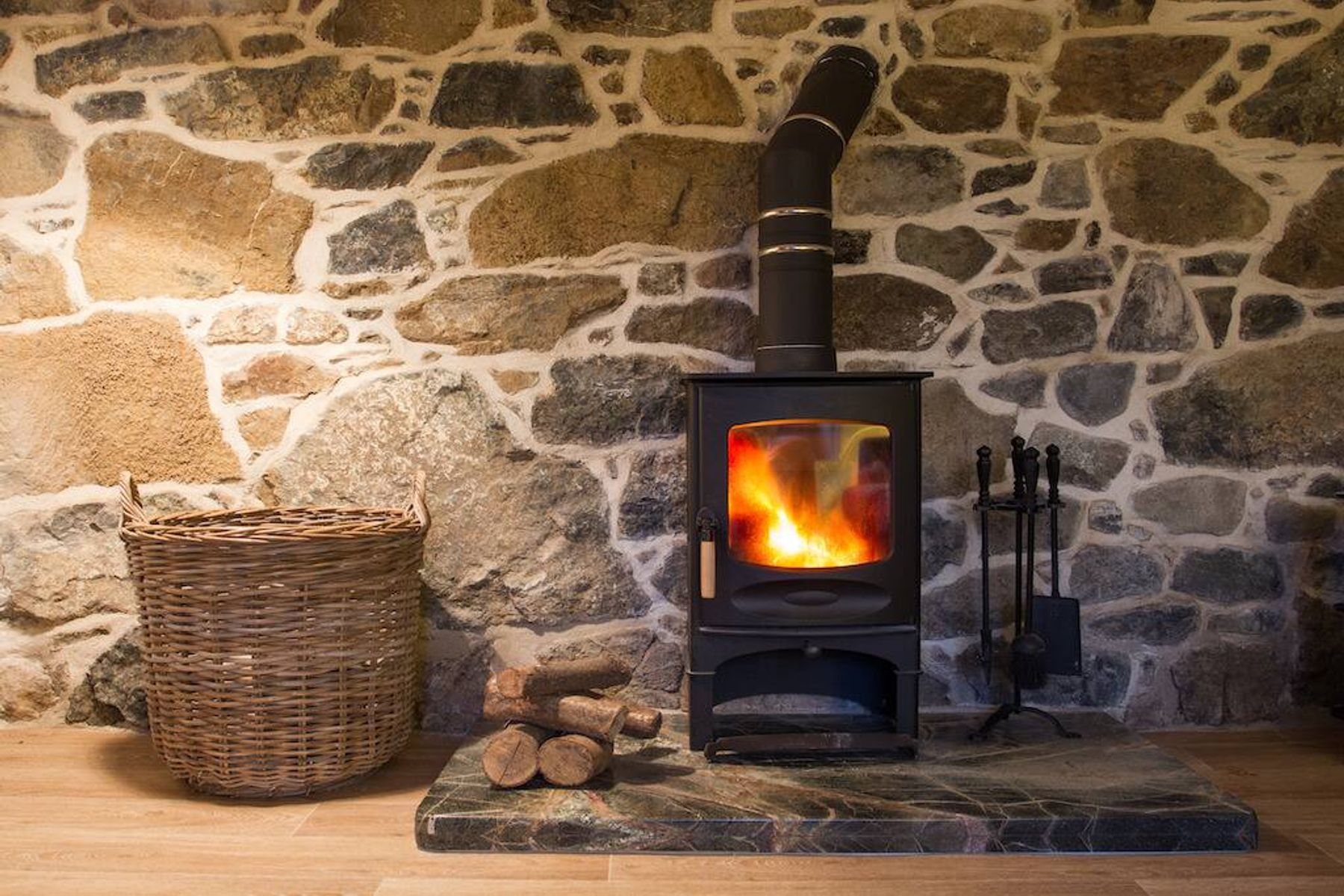 How to clean a log burner: wood burner in a living room