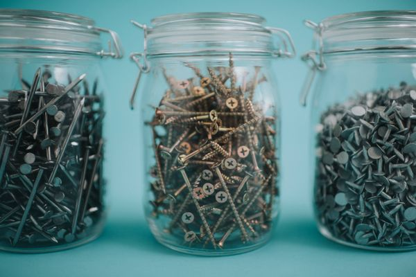 three jars of screws for garage organisation systems