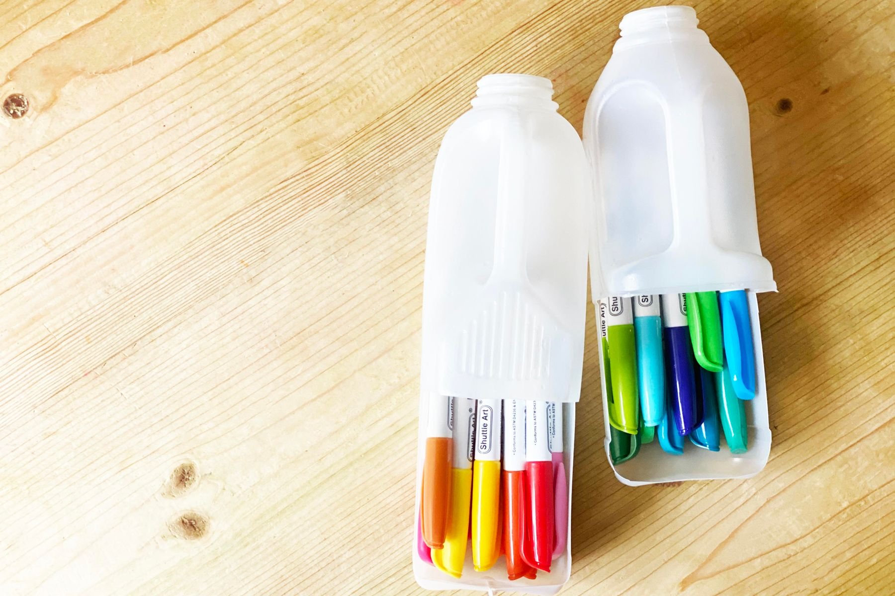Milk bottles that have been upcycled into pen holders