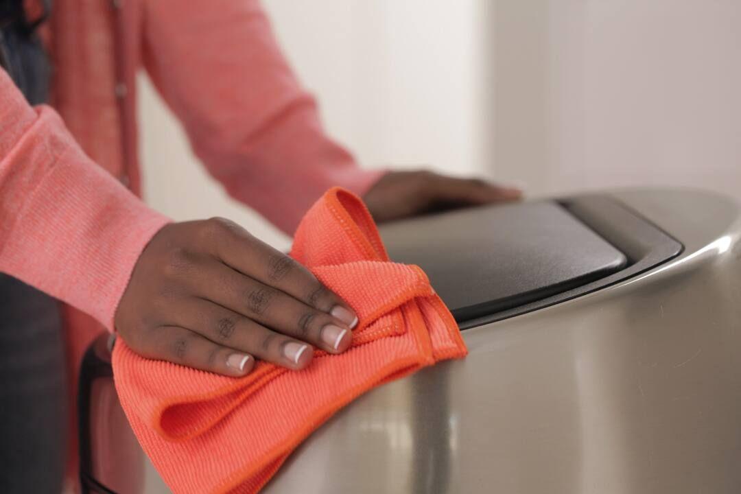 Woman cleaning bin