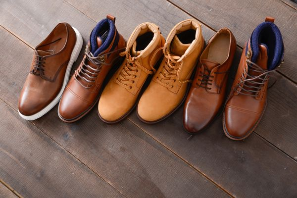 a selection of leather boots in a line