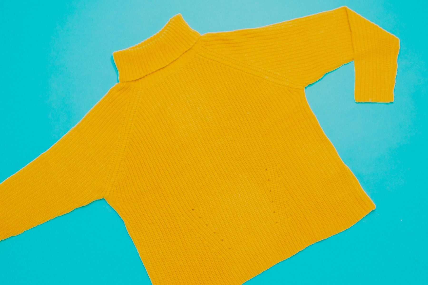Yellow jumper made of wool, which is on the list of what causes eczema flare-ups