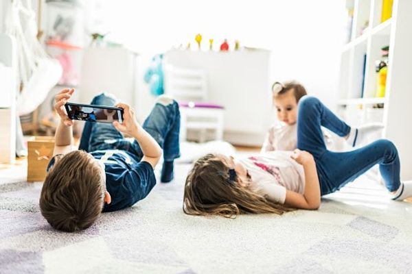 Children playing on the bedroom floor