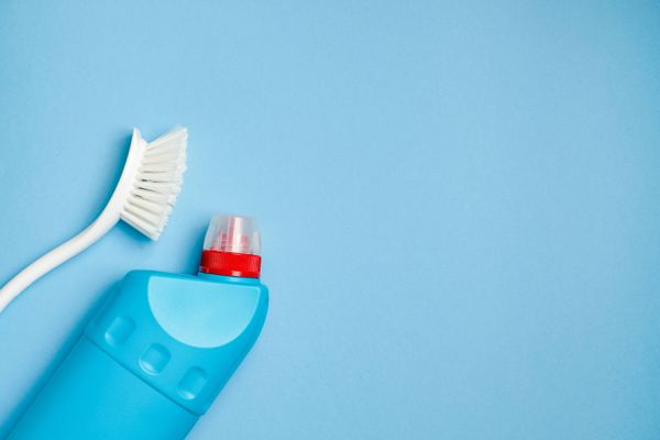 cleaning brush with bleach to remove limescale