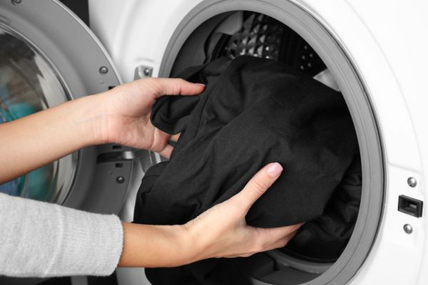 Here's how you can add some coffee to your washing machine and keep your blacks black