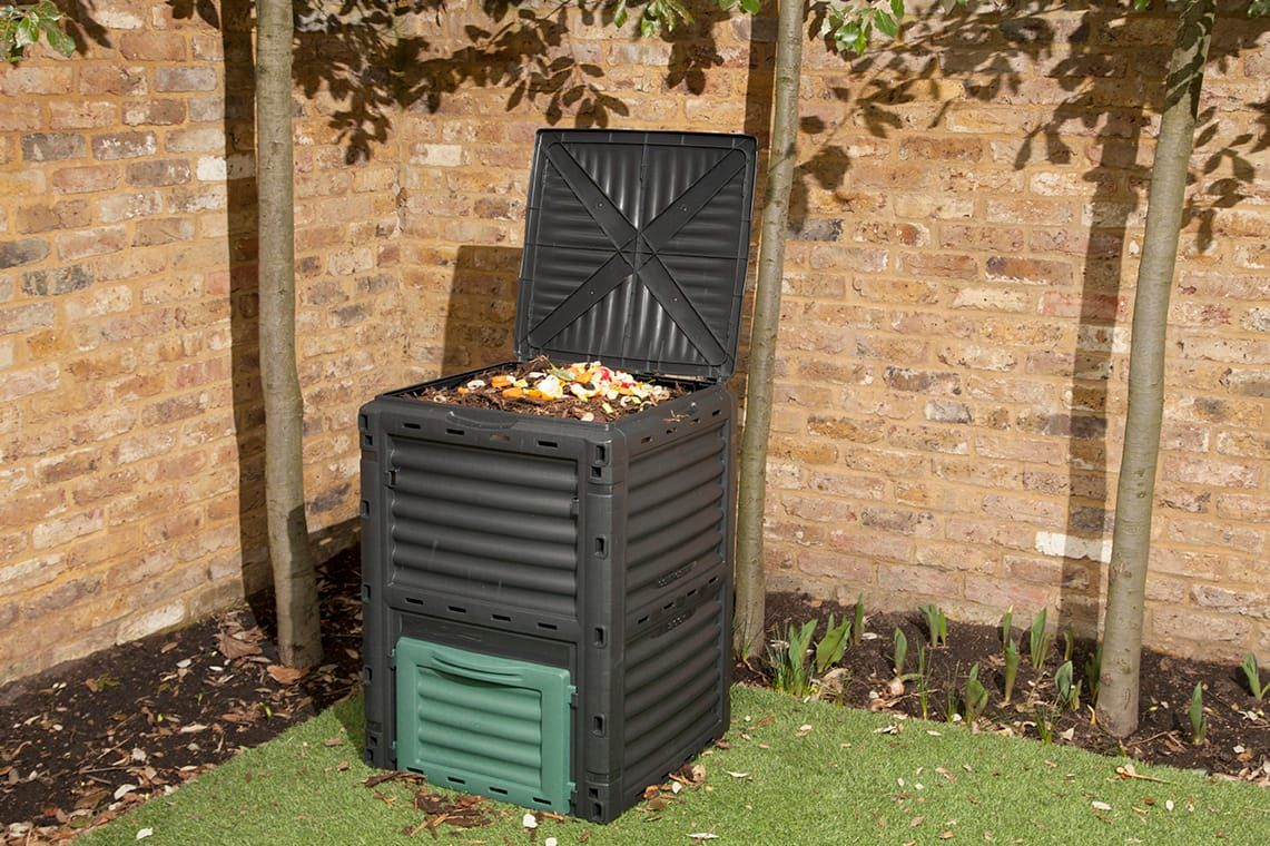 large compost bin in garden