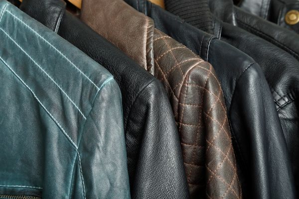 Row of clean leather jackets on hangers