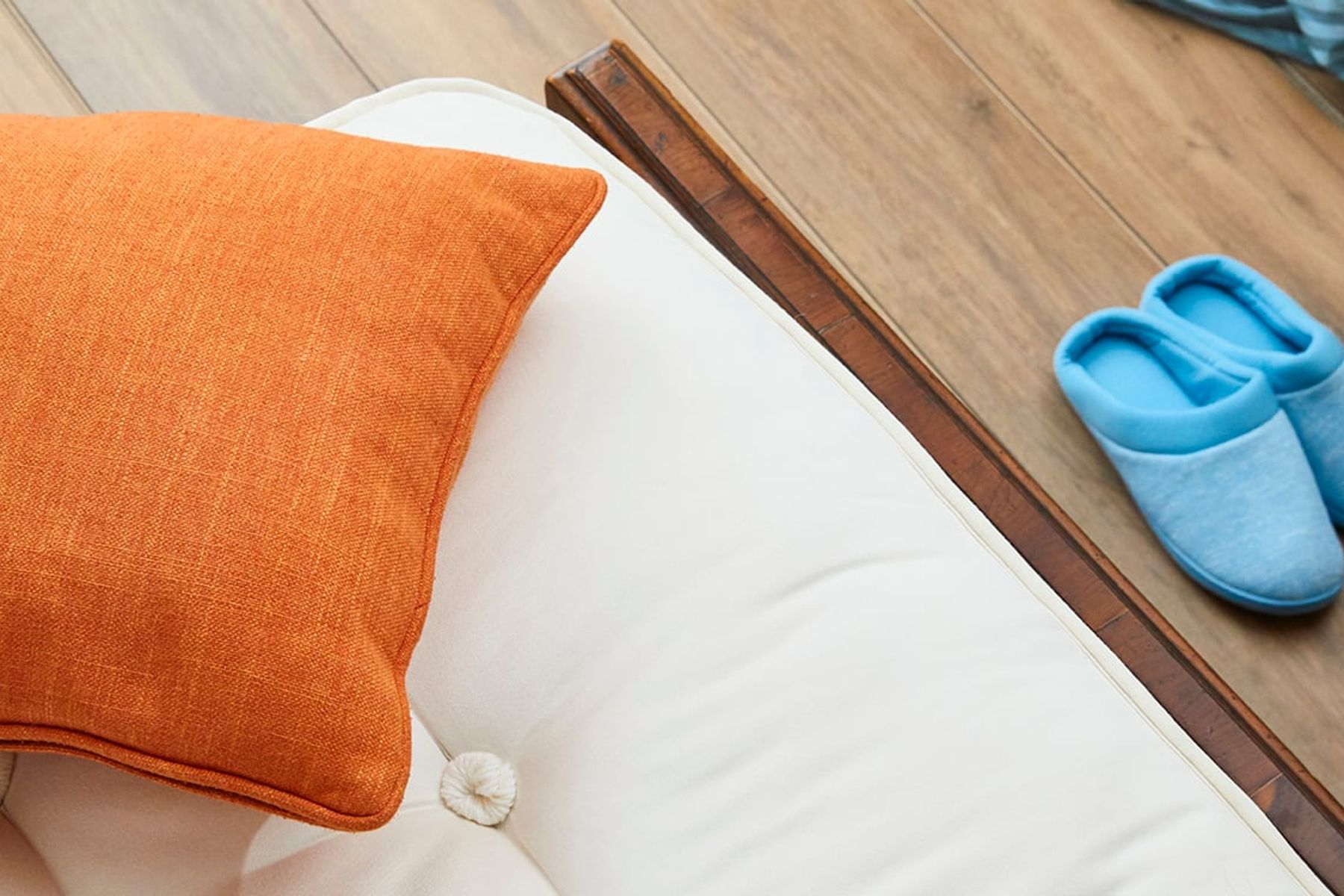 clean pillow top mattress with an orange cushion