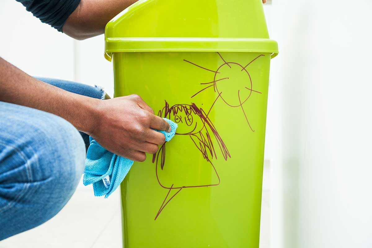 Cleaning permanent marker from a bin using a cloth
