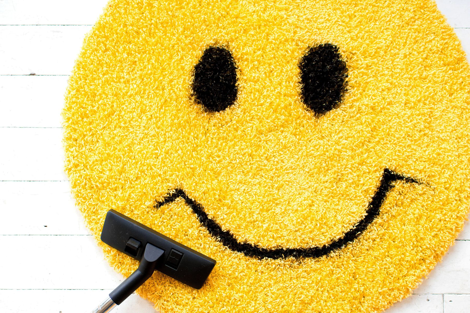 Smiley face rug for cleaning with kids