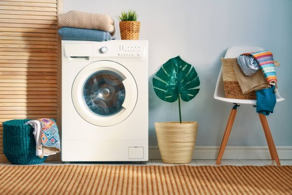 Washing machine with pile of clothes