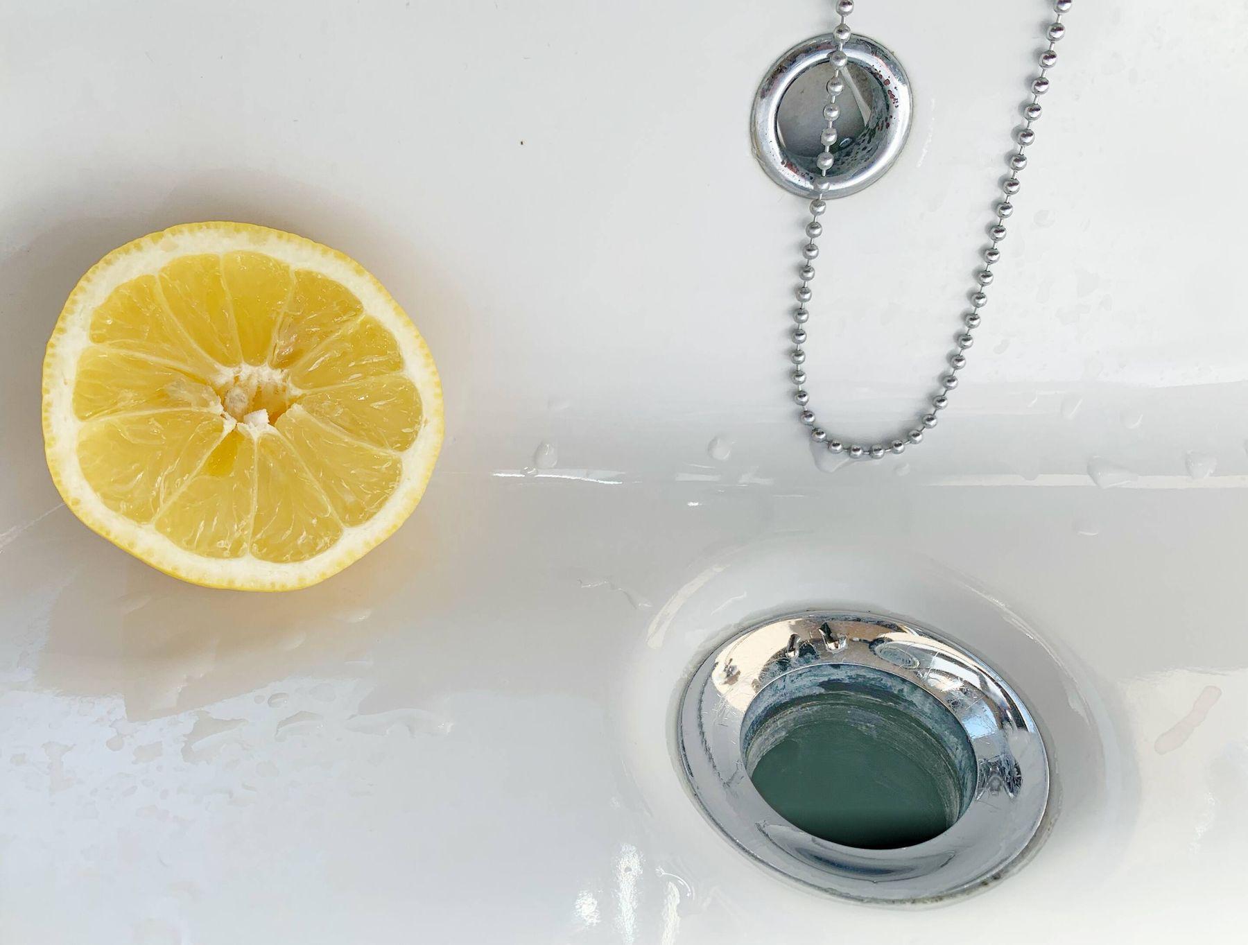 half lemon in the bathroom sink