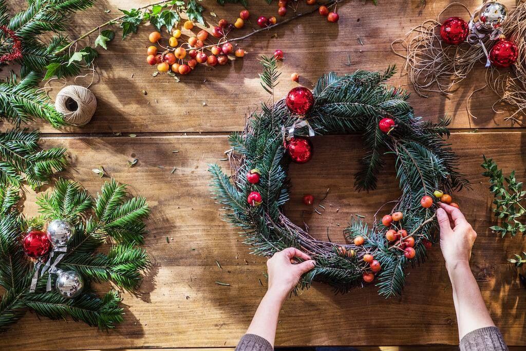 Hands making a DIY Christmas garland