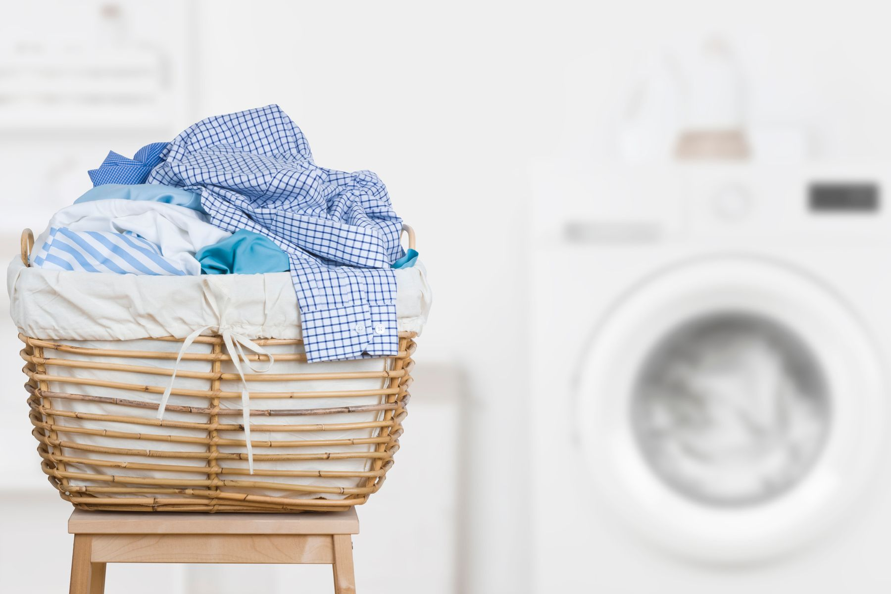 Pile of laundry about to be put into the washing machine to remove odours from clothes
