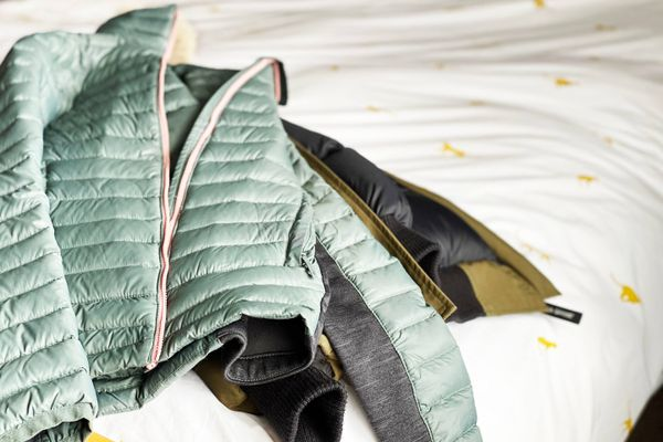 Down jacket on a bed.