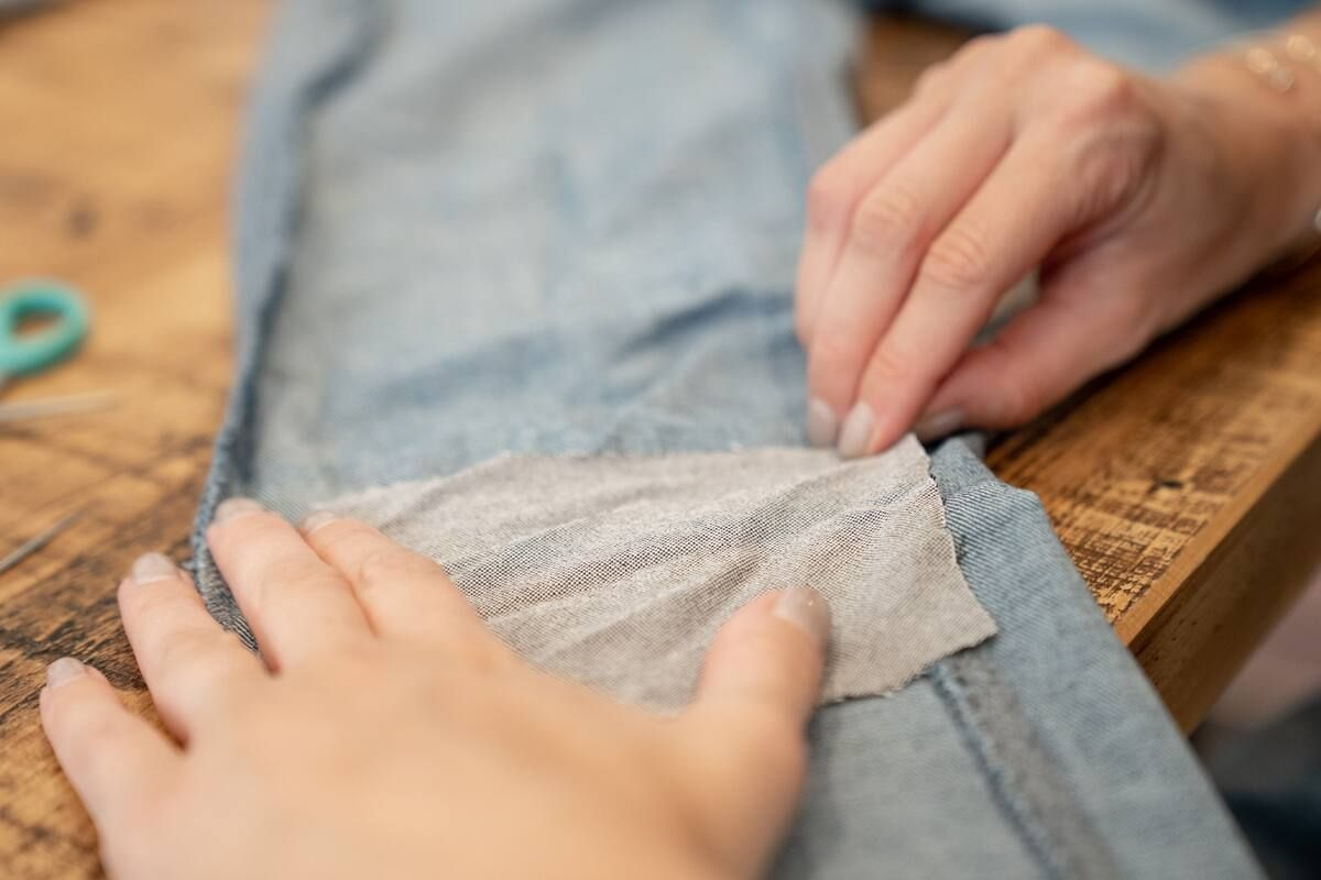 Mending jeans using a denim patch