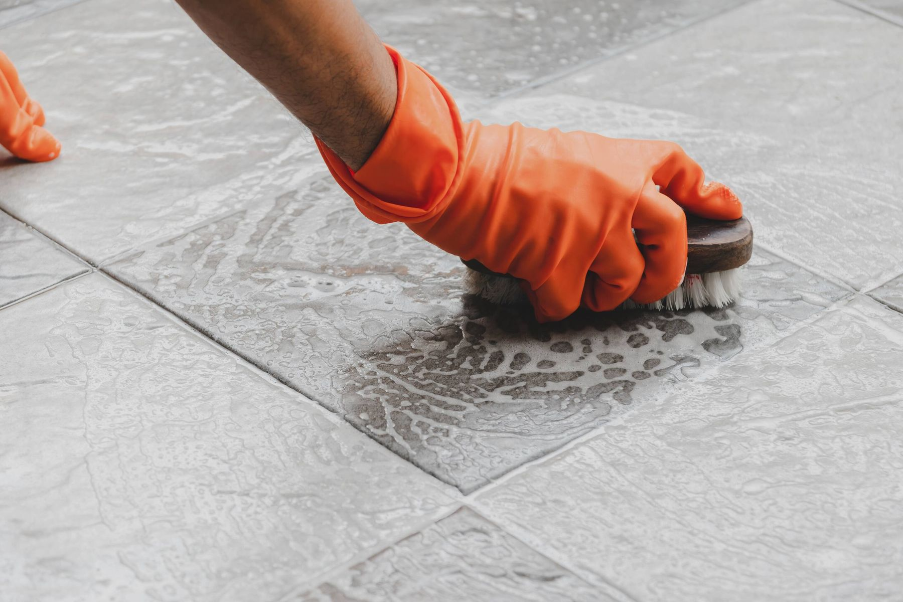 hand scrubbing kitchen tiles