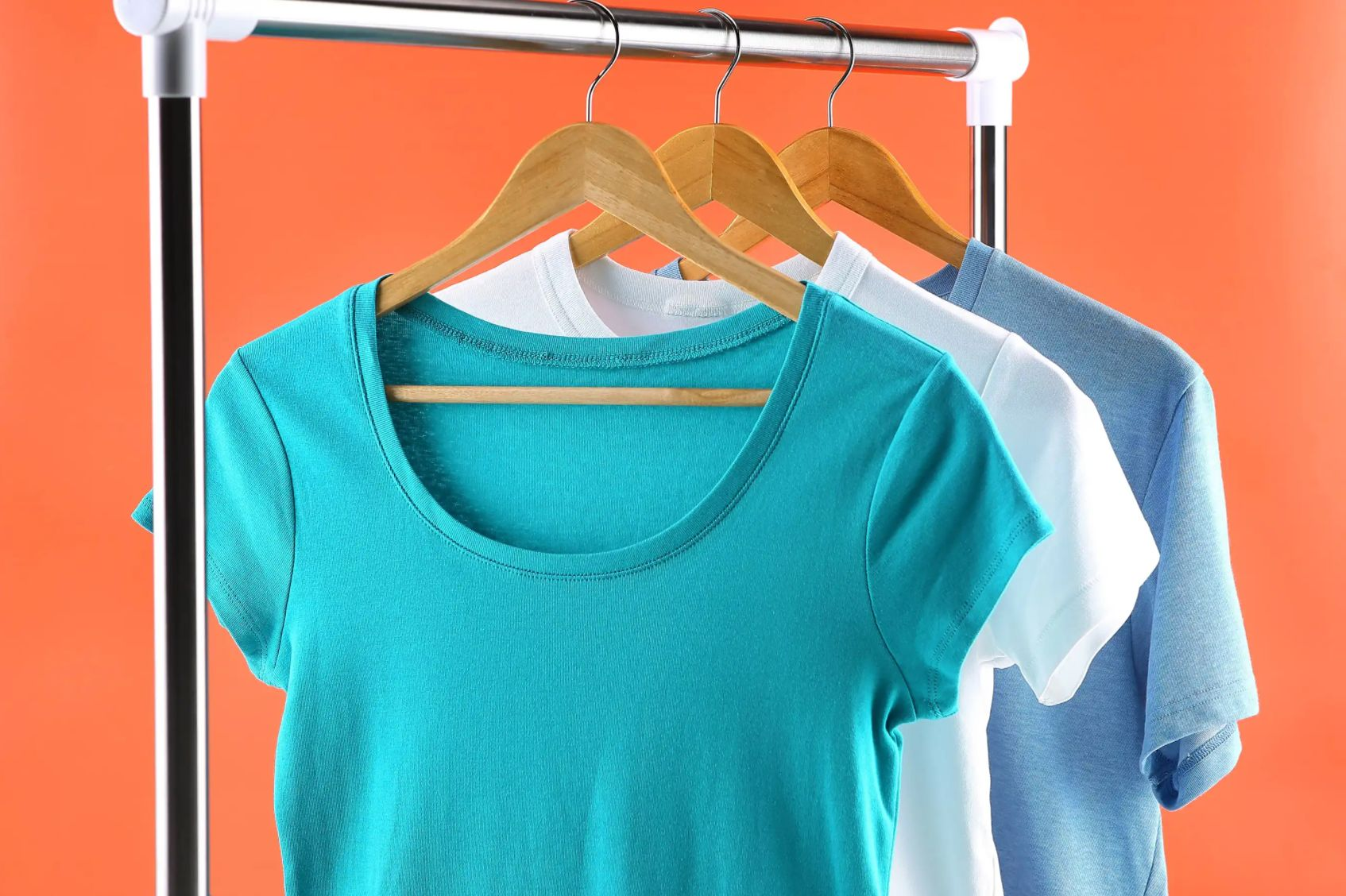 clothing rail with a selection of coloured shirts