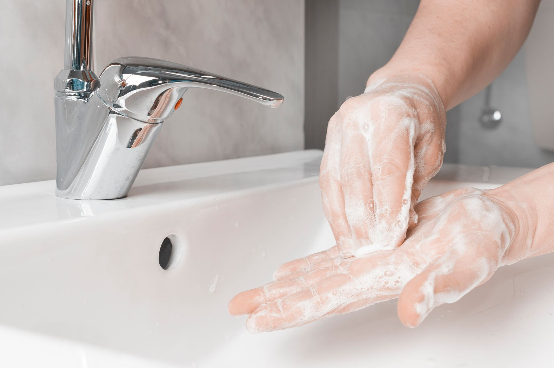 Step 2: person making bubbles with soap for hand washing