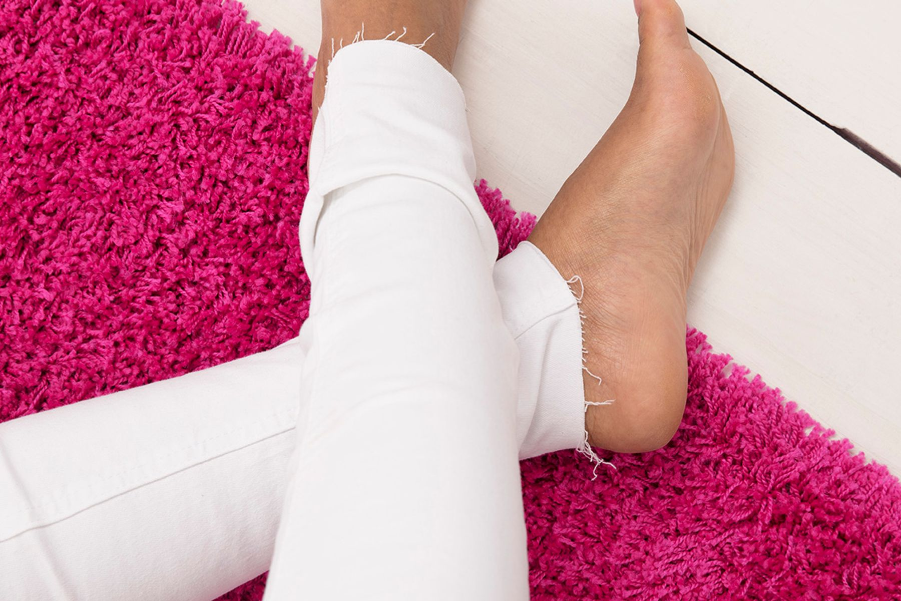 clean white jeans on a pink carpet
