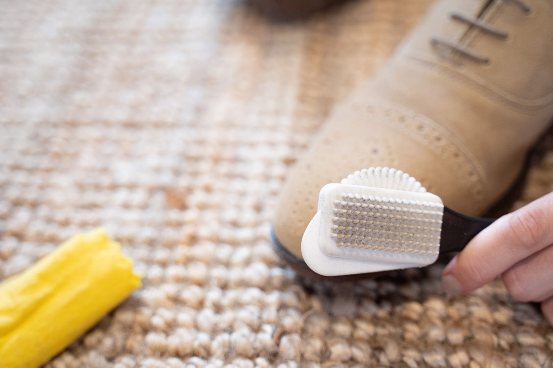 A brush being used on nubuck shoes