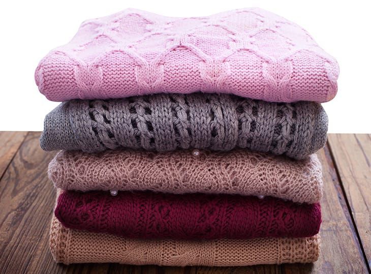 Pile of winter jumpers