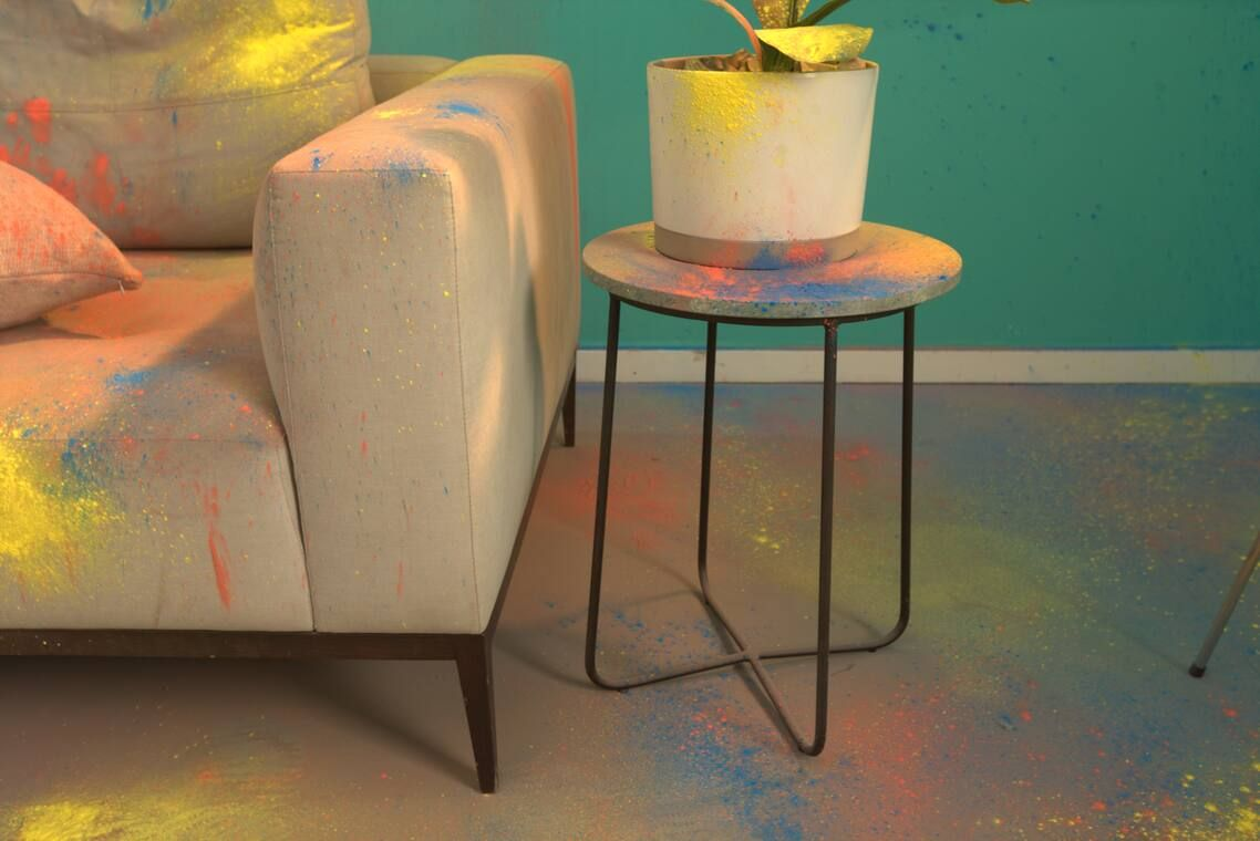 spray paint stains on sofa, carpet, and table