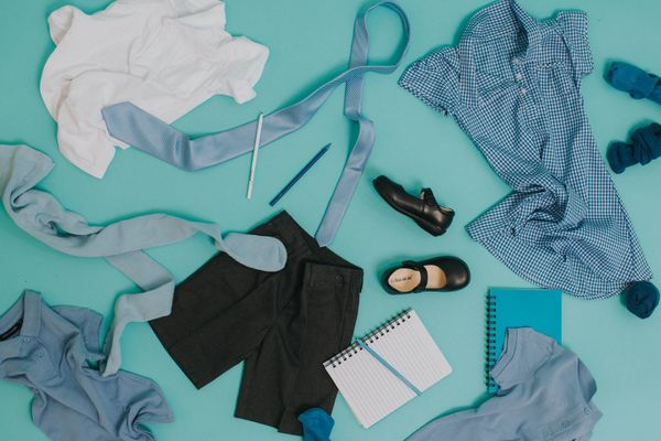 a variety of school uniform clothing on a blue background