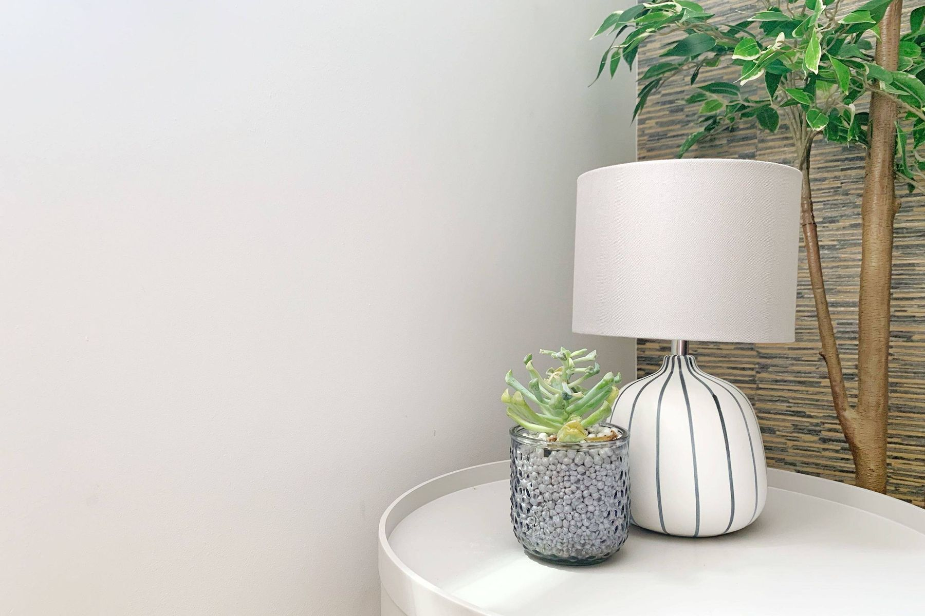 clean white lampshade beside green plants